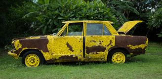 Old yellow car. Old yellow car with hole and rust cover Royalty Free Stock Photos