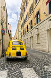 Old Yellow Car in Rome Royalty Free Stock Image