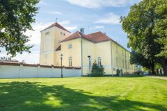 Old yellow castle at Latvia. Historical building. Town Ventspils, old yellow castle, orange ruff.  Latvia 2015 Travel photo Royalty Free Stock Photography