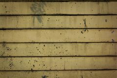 Old yellow wall tiles are stacked. royalty free stock photography