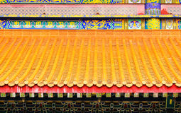 The old yellow Chinese style roof Royalty Free Stock Photos