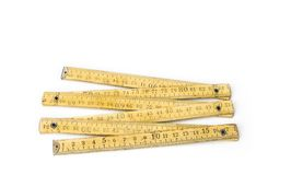 Old yellow construction folding meter on the white background Stock Images