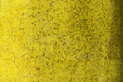 An old yellow crack ceramic tiles wall Royalty Free Stock Photo