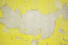 Old yellow cracked on the concrete wall. Royalty Free Stock Image
