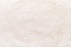 Old yellow crumpled paper background texture Stock Photography