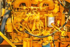 Old yellow diesel engine details Royalty Free Stock Images