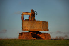 An old yellow digger sat unloved Stock Images
