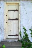 Old yellow door Stock Photography