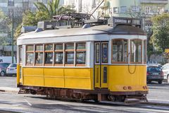 Old yellow tram in the streets of Lisbon stock images