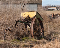 Old yellow farm equipment Stock Photography