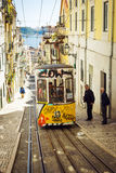 Old yellow funicular on narrow street of Lisbon, Portugal Stock Image