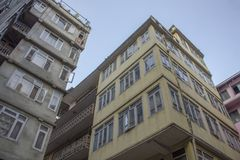 Old yellow and gray low-rise city houses. A old yellow and gray low-rise city houses royalty free stock photo