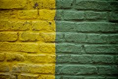 Old yellow and green brick wall Stock Photos