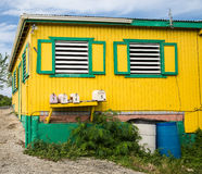Old Yellow and Green Building with Window Vents Royalty Free Stock Images