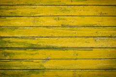 Old yellow-green wooden painted planks. Abstract background Stock Photos