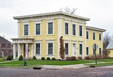 Old Yellow Italianate Square House royalty free stock photography