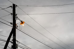 An old yellow lantern on the cloudy skies Royalty Free Stock Photography