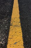 Old yellow line on road background. Stock Photo