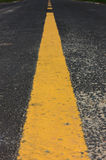 Old yellow line on road background. Royalty Free Stock Photography