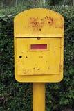 Old yellow mailbox Stock Photos