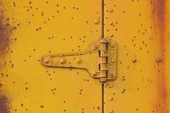 Old Yellow Metal Door Hinge Royalty Free Stock Photo