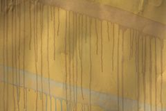 Old yellow metal sheet with blue and pink streaks of paint with smudges. rough surface texture royalty free stock photo