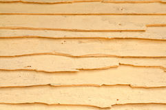 Old yellow painted wooden wall Stock Images