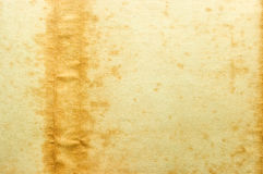 Old yellow paper with stain on the left Royalty Free Stock Images