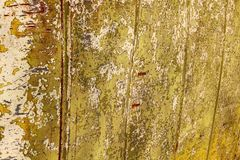 Old yellow peeled paint background Royalty Free Stock Image