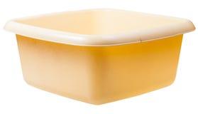 Old yellow plastic rectangular wash basin isolated Stock Image