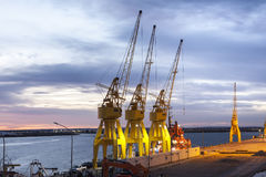 Old yellow port cranes in Huelva, Spain Royalty Free Stock Images