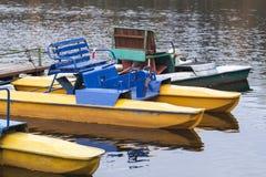 Old yellow promenade catamarans moored Stock Image