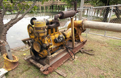 Old yellow pump machine Stock Photography