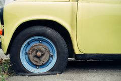 Old yellow retro car. With a punctured broken wheel stock photo