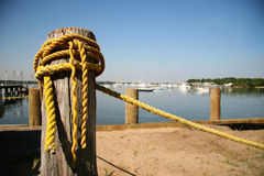 Old yellow rope. At marina Stock Photography