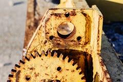 Old yellow rusty metal gear Stock Image