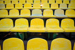 Old yellow seat in stadium closeup Royalty Free Stock Photos