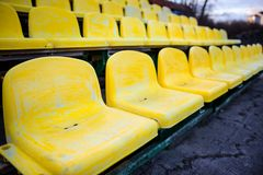 Old yellow seat in stadium closeup royalty free stock images