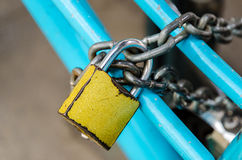 Old yellow security key lock and chain Stock Photos
