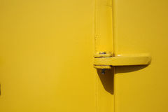 Old yellow ships door and bolt close up as background Royalty Free Stock Photography