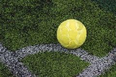 Old yellow Soccer Ball at corner Royalty Free Stock Photos