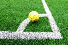 Old yellow soccer ball Royalty Free Stock Image