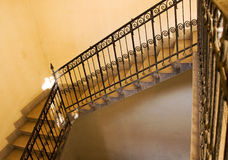 Old yellow staircase. A photo depicting a yellow painted staircase Royalty Free Stock Photo