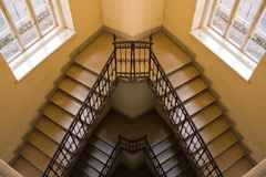Old yellow staircase reflection. A photo depicting a yellow painted staircase Royalty Free Stock Photography