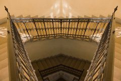 Old yellow staircase reflection. A photo depicting a yellow painted staircase Royalty Free Stock Photo