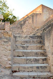 Old yellow stone staircase of limestone in the Santa Barbara castle, Alicante, Spain Royalty Free Stock Images