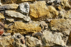 Old yellow stoned brick wall Royalty Free Stock Photography