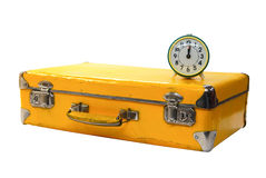 Old yellow suitcase with green alarm clock Stock Photography