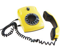 Old yellow telephone Royalty Free Stock Image