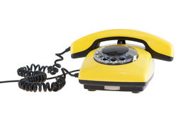 Old yellow telephone Stock Images
